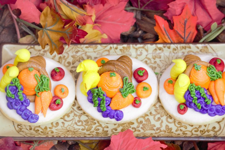 cornucopia decorated, buttercream-icing-food-vegetables-horn-of-plenty-scarecrow-cookiesfall-pupmkins-patch-thanks-gobble-turkey-thanksgiving-table-place-holder-barrel-cinottis-bakery-autumn-leaves