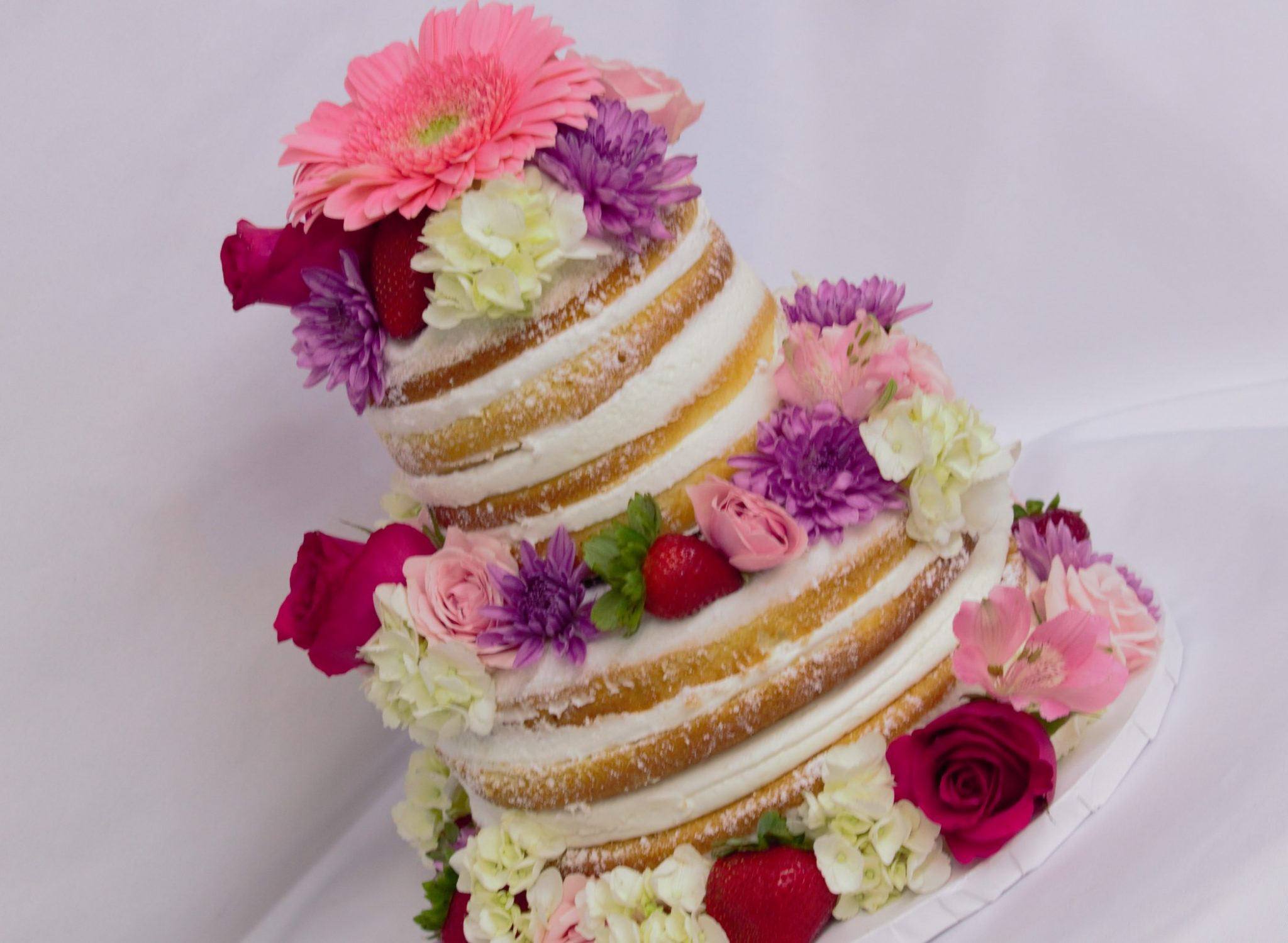 Naked cake with flowers a trendy cake from cinottis bakery naked cake with flowers mightylinksfo